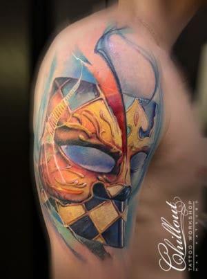 Татуировка Маска Баута на плече